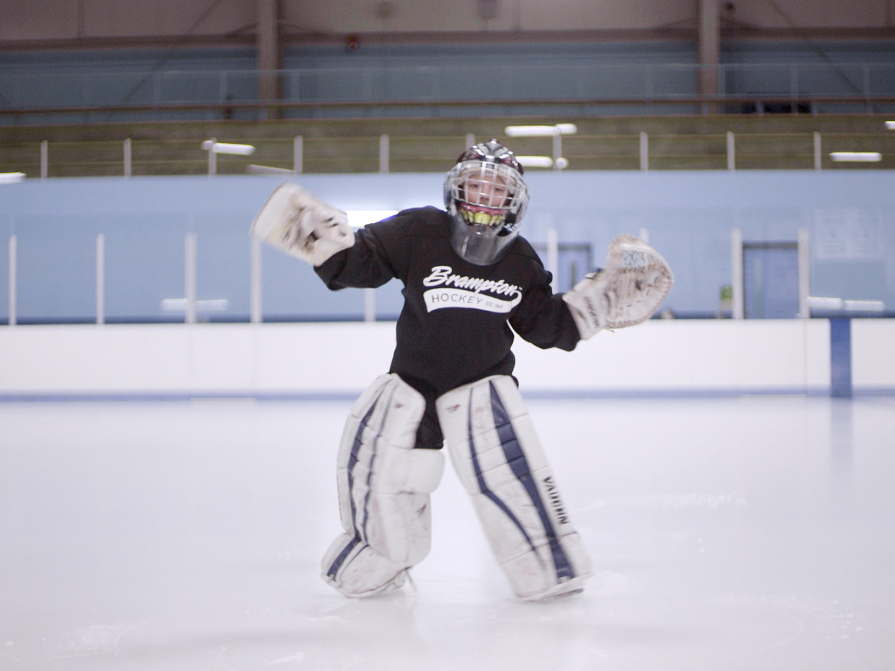 Young boy named Noah dancing in goalie gear on ice