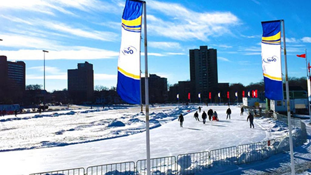 Frozen river with apartment buildings in the background