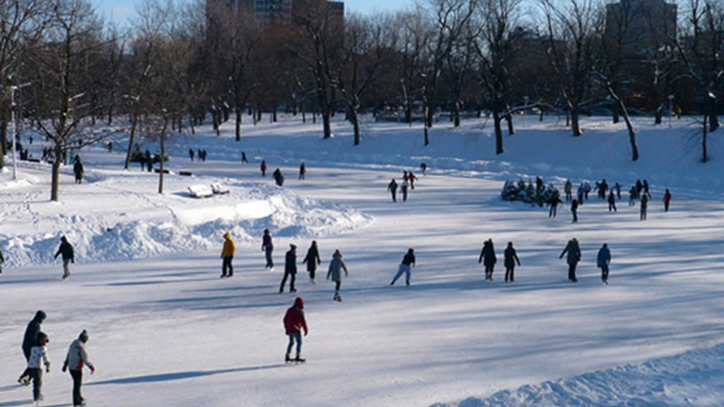 People skating on a wide canal