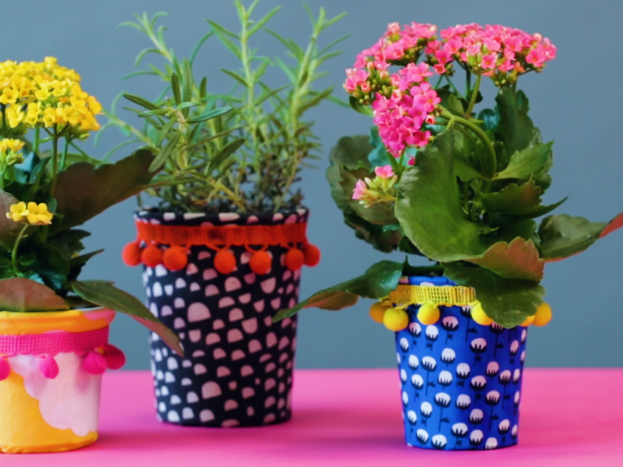 Yogurt containers covered with fabric and filled with plants