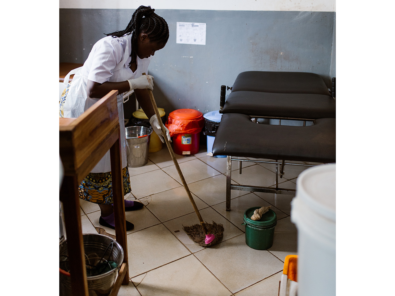 Nurse cleaning the floor after birth