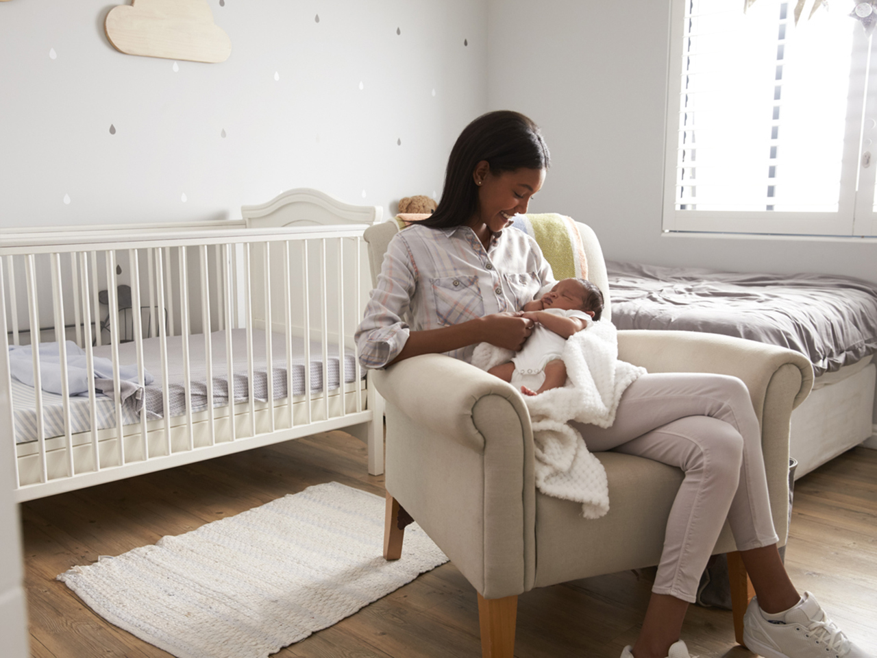 Mother Home from Hospital With Newborn Baby In Nursery