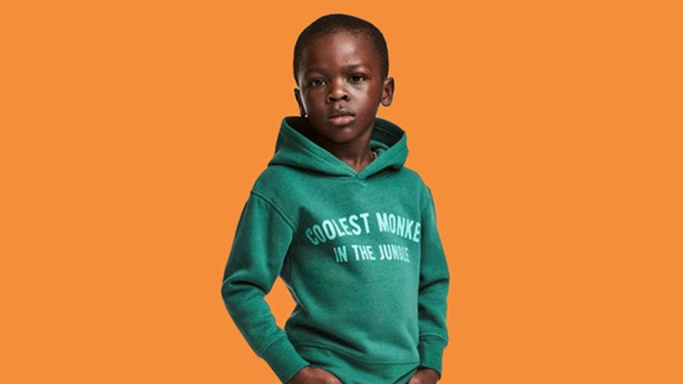 Young boy in an offensive green hoodie sweatshirt