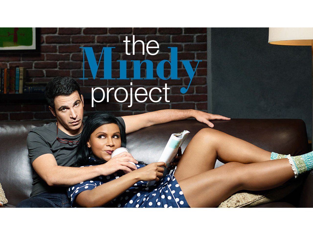Promo Image for The Mindy Project showing a couple laying on a leather sofa
