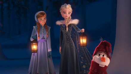 Elsa and Anna holding lanterns while looking down at Olaf in Olaf's Frozen Adventure