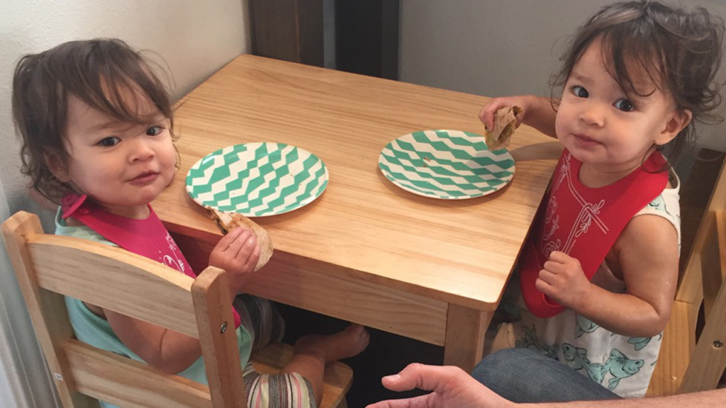 The author's daughters eating a snack at a small table
