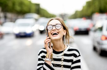A woman in breton stripes laughing