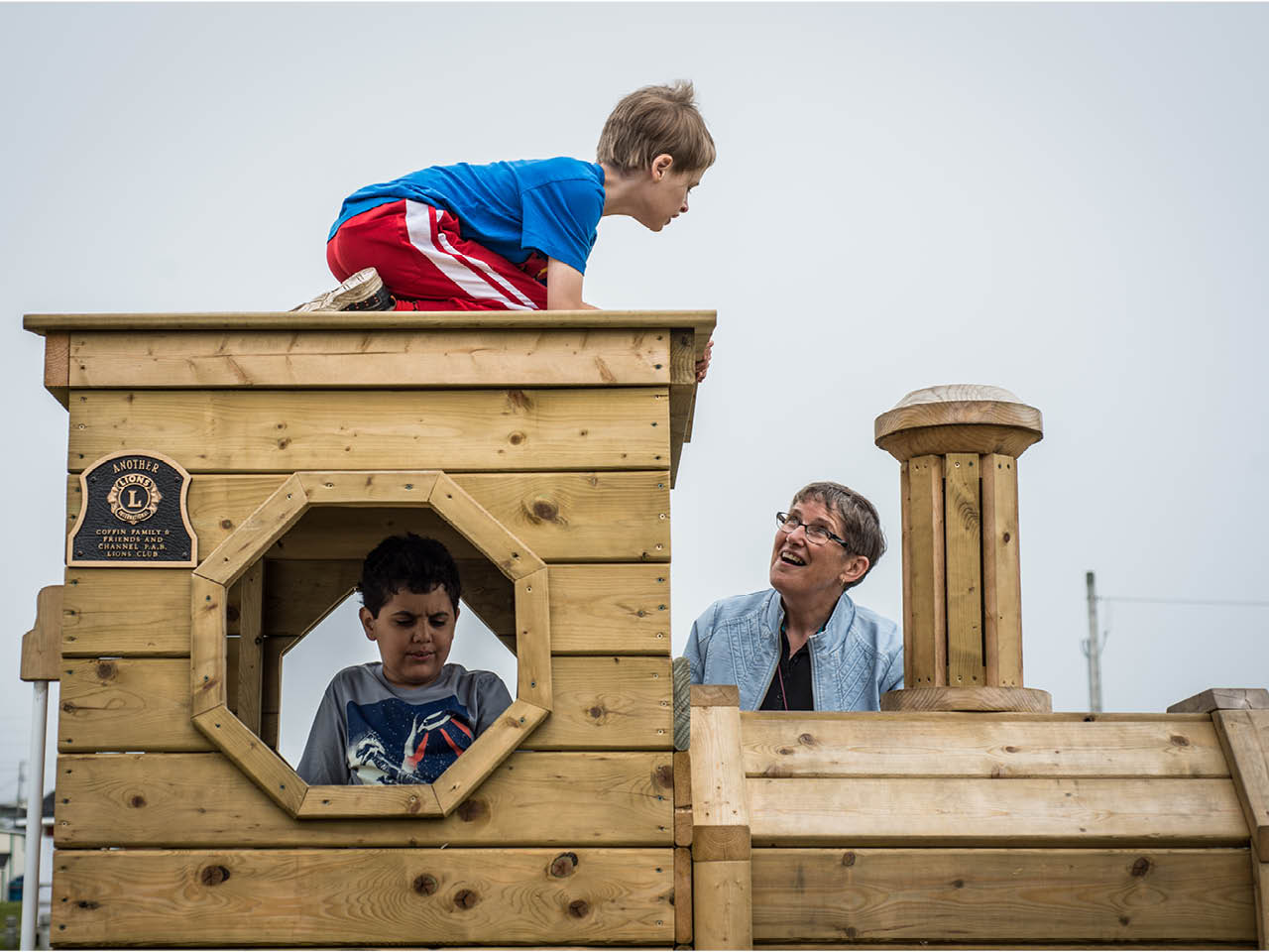 Autism Town - Gallery Image 1 - Issac and Elyas playing with Joan Chiasson