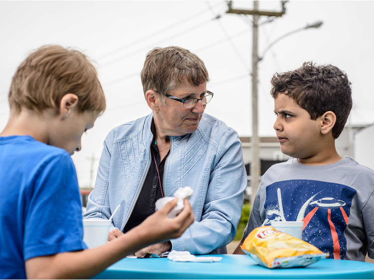 Autism Town - Gallery Image 2 - Issac and Elyas eating with Joan Chiasson