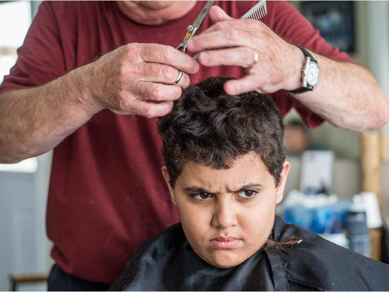Autism Town - Gallery Image 1 - Elyas getting a haircut