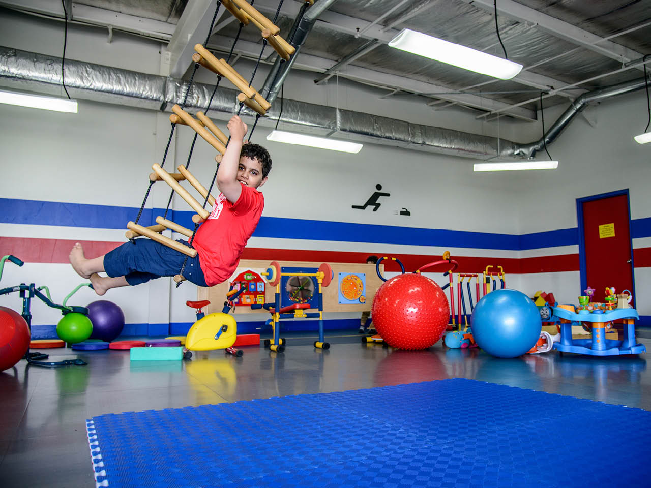 Autism Town - Gallery Image 3 - Elyas in the mini-gym at the Bruce II Sports Centre