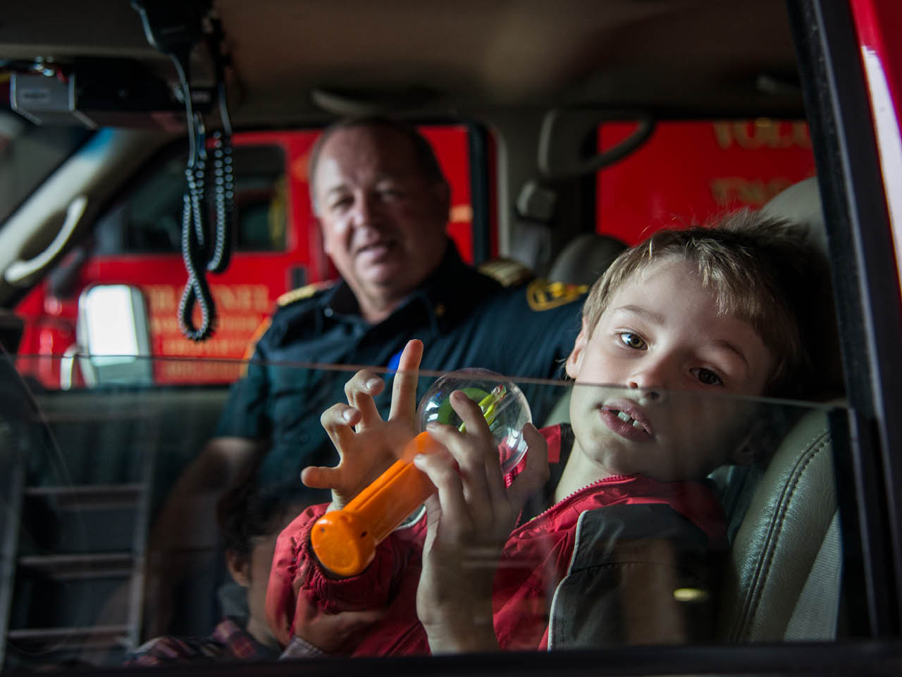 Autism Town - Gallery Image 2 - Fire Chief Jerry Musseau with Isaac