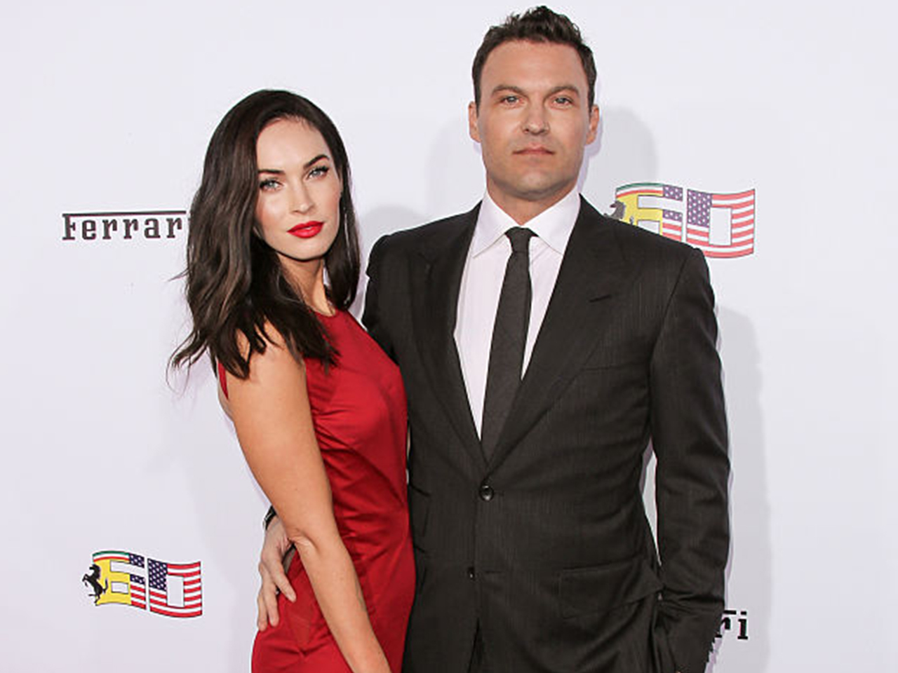 Actors Megan Fox (L) and Brian Austin Green (R) attend Ferrari's 60th Anniversary In The USA Gala at the Wallis Annenberg Center for the Performing Arts