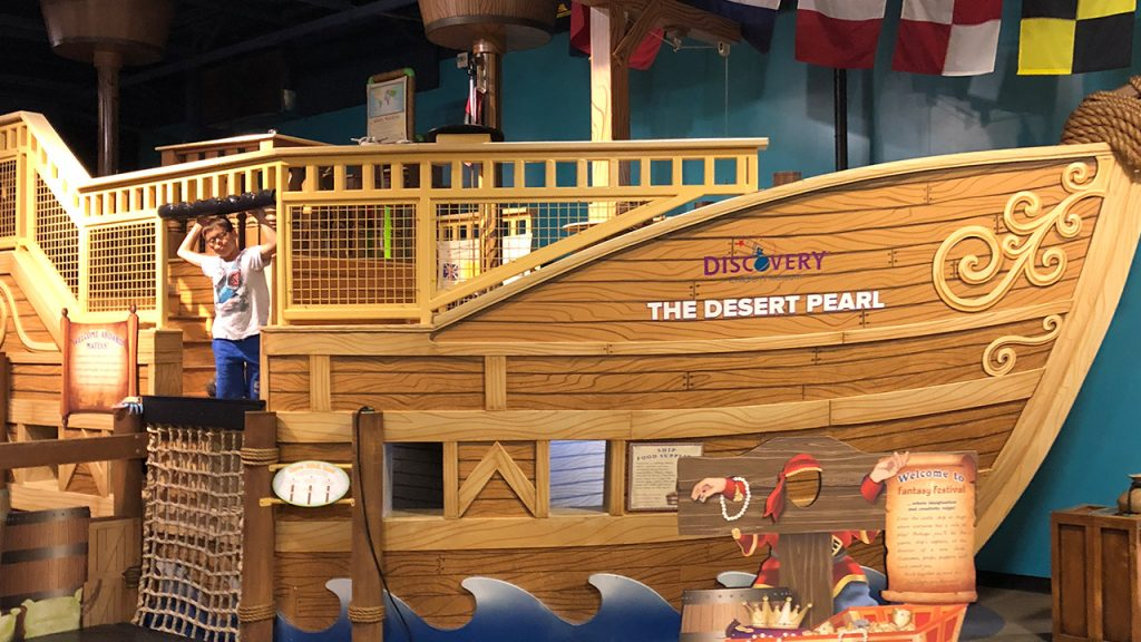 Photo Of Kims Son In A Fake Wooden Ship At The Discovery Childrens Museum