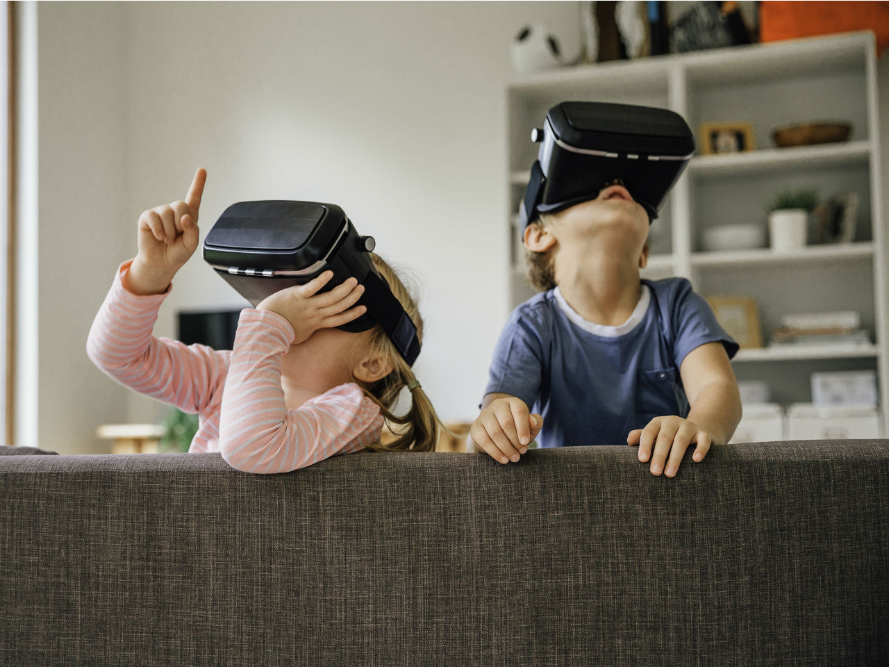 Two kids playing with VR glasses