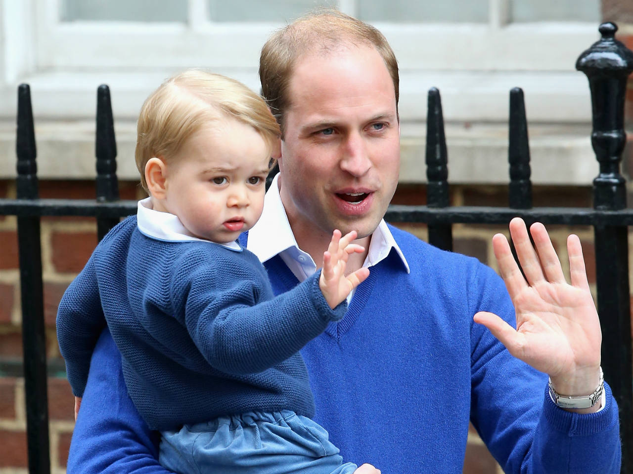Prince George and Prince William waving