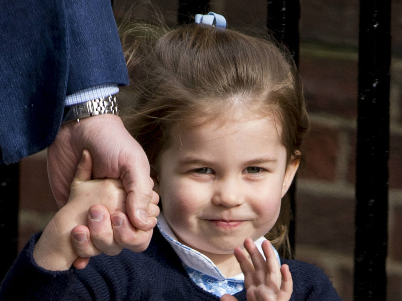 Princess Charlotte waves to crowd