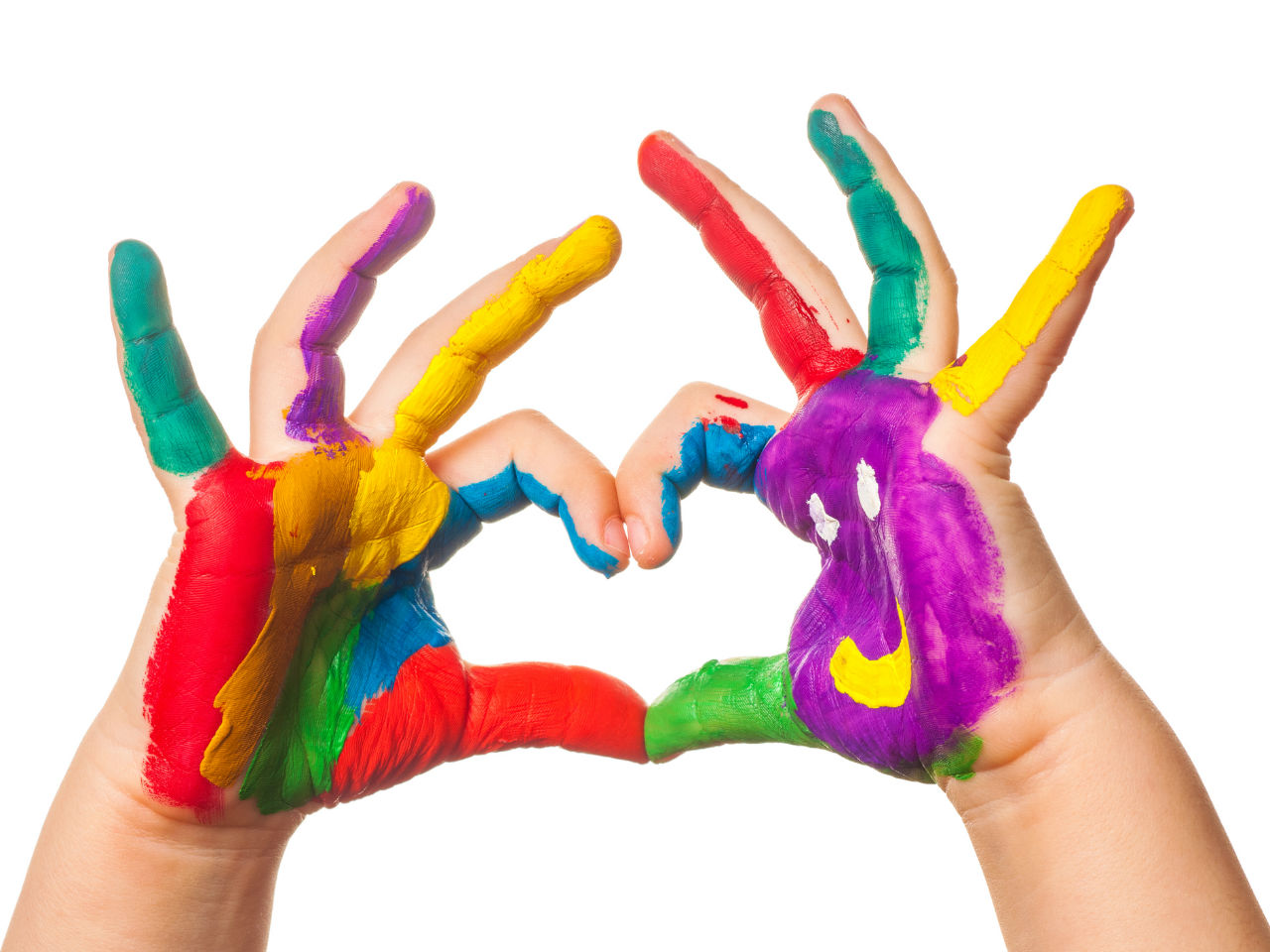 Kid making a heart shape with his fingers, with colourful painted hands.