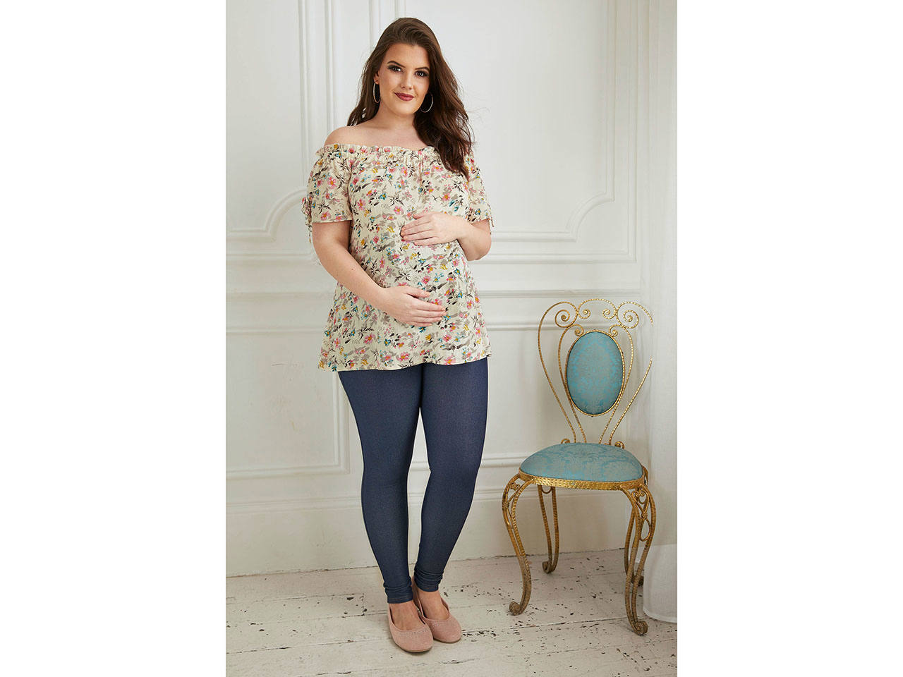 61845bae3 A pregnant woman in a floral maternity top Photo  Yours Clothing