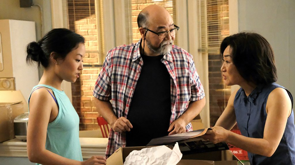 Promo image for Kim's Convenience showing a mom and dad talking to their adult daughter