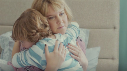Amy Schumer as a mom hugging her son