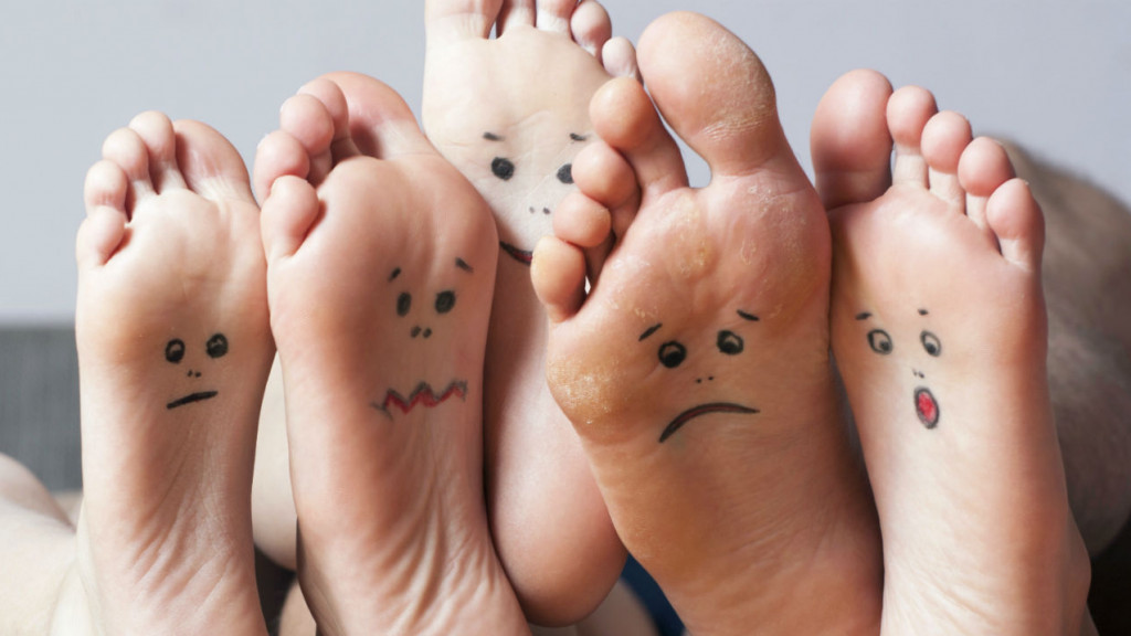 Human soles with faces made on them