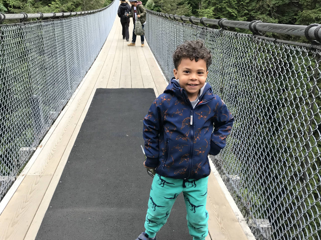 A little boy standing on the Capitano Suspension Bridge in Vancouver