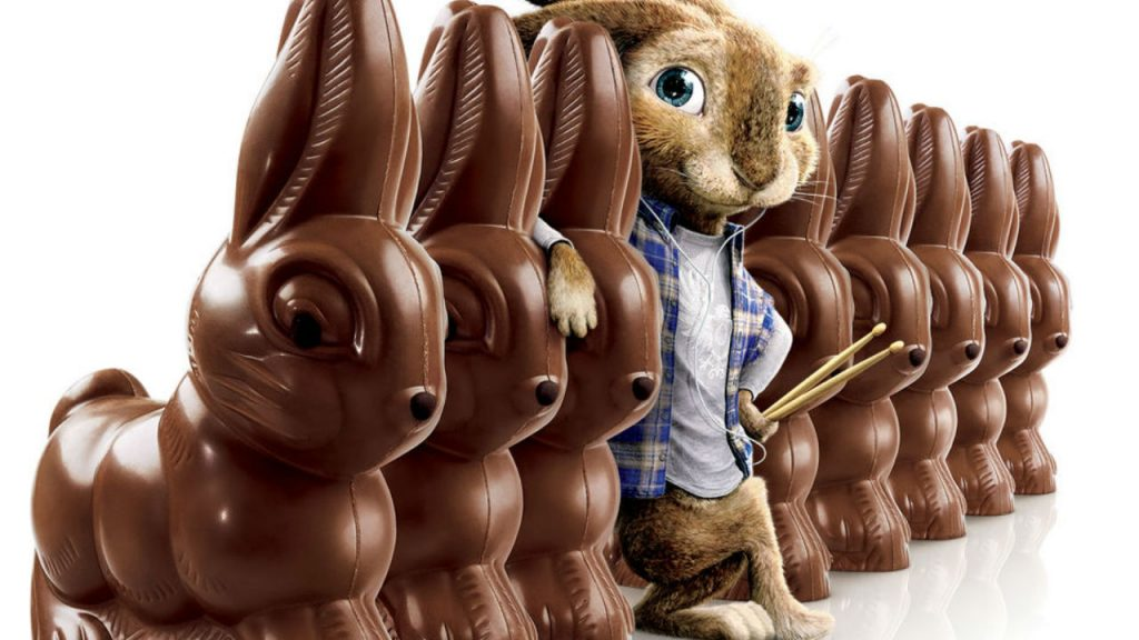 Bunny standing with chocolate bunnies