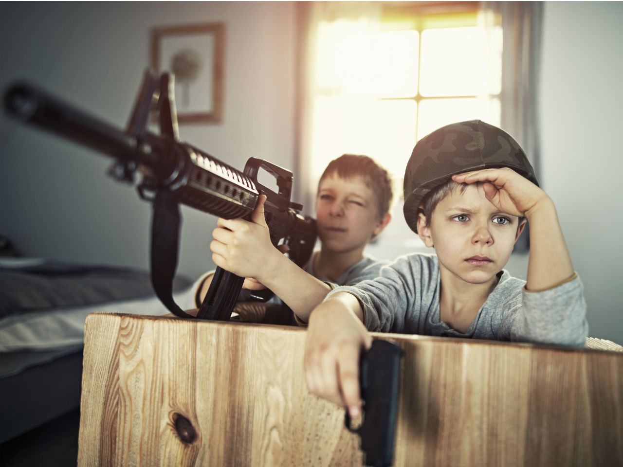 kids playing with real guns