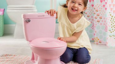 little girl with pink potty