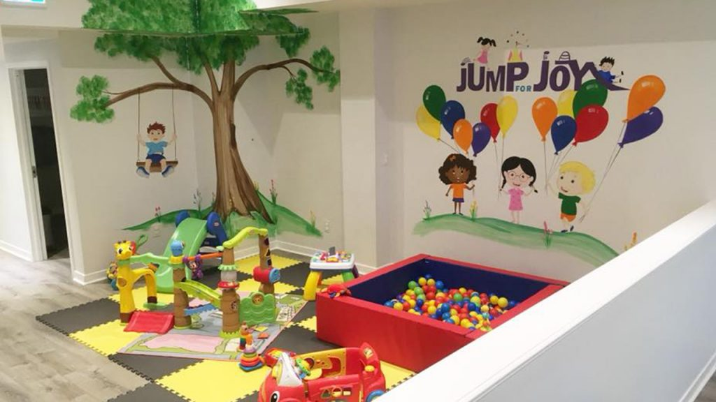 Toddler area with padded floors and a small ball pit
