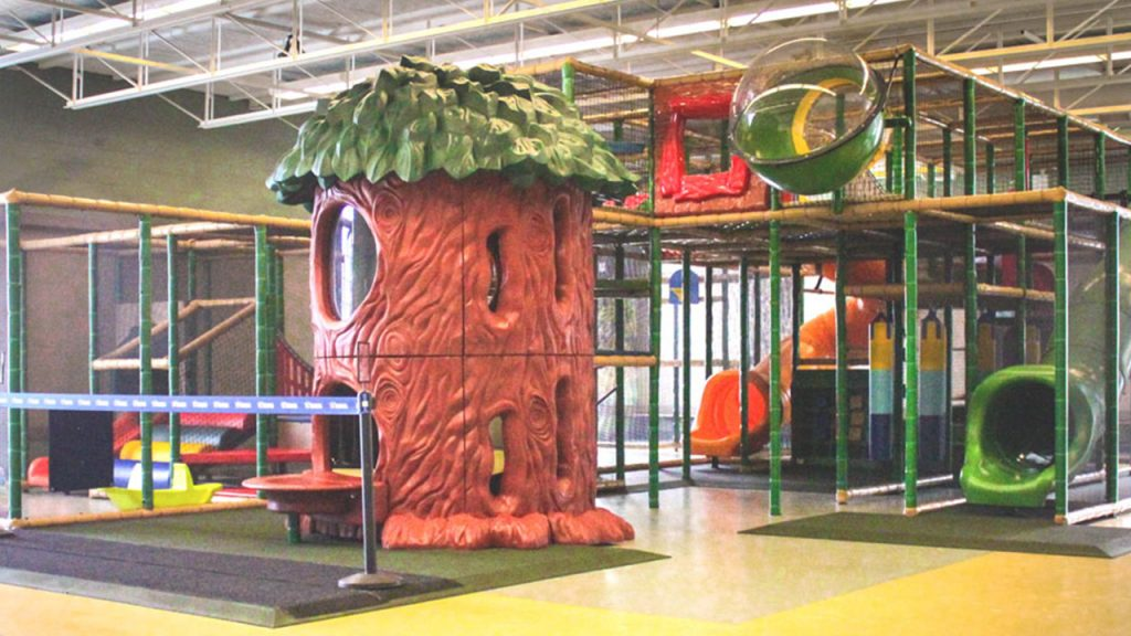 Play structure with slides and a giant tree house