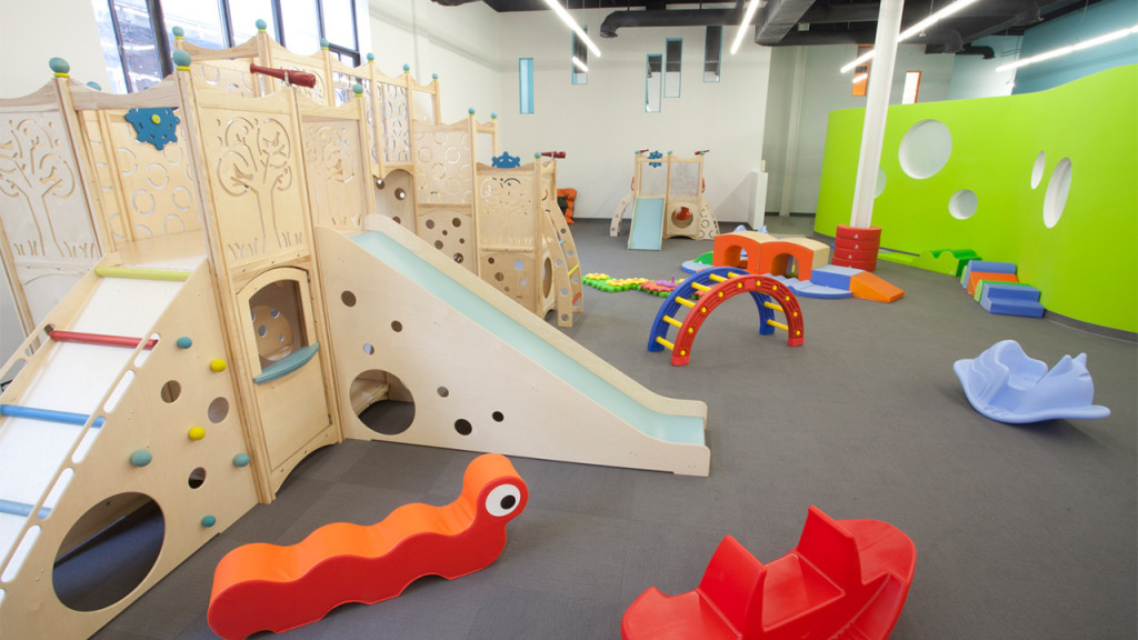 Wooden play structures in a large play room