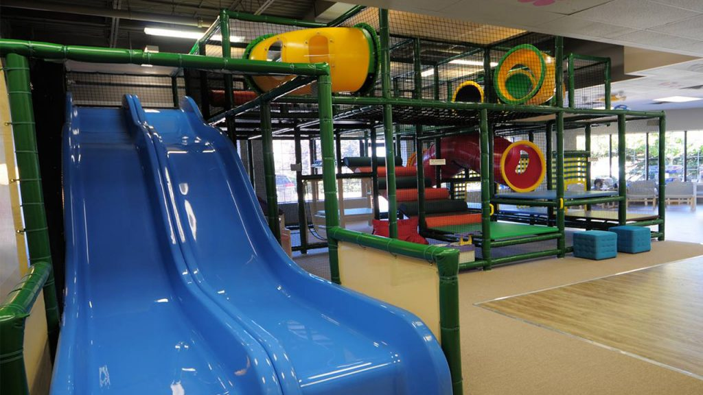 Large play structure with tubes and a big dual slide