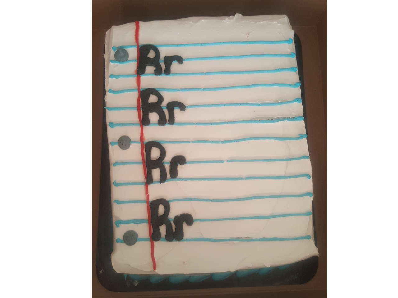 A picture of a cake with the letter R on it