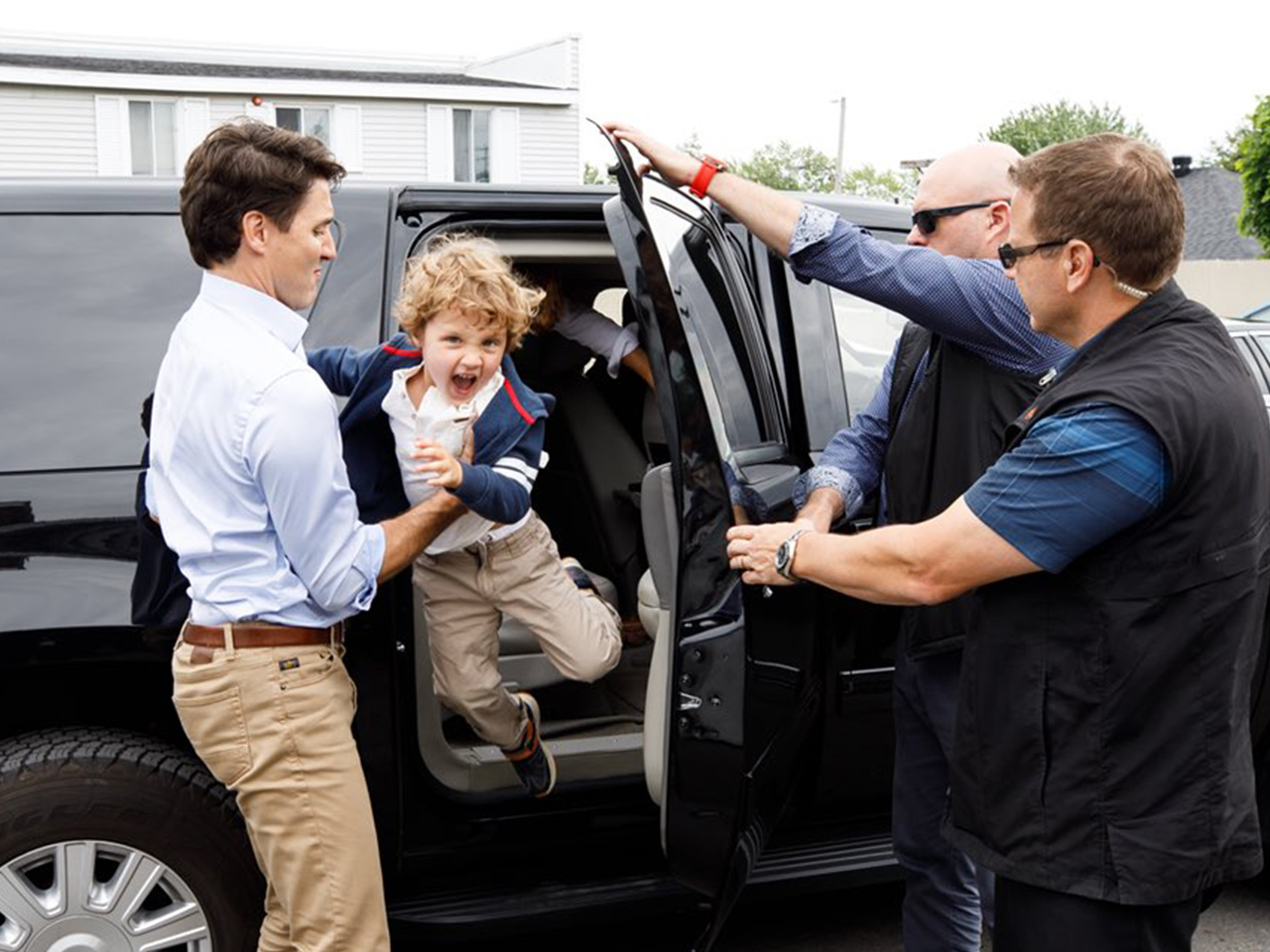 Hadrien Trudeau jumping out of a car into Justin's arms