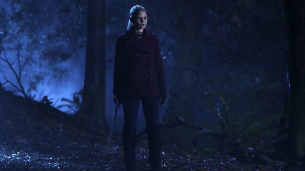 Promo image for Once Upon a Time showing a a woman standing in the woods at night