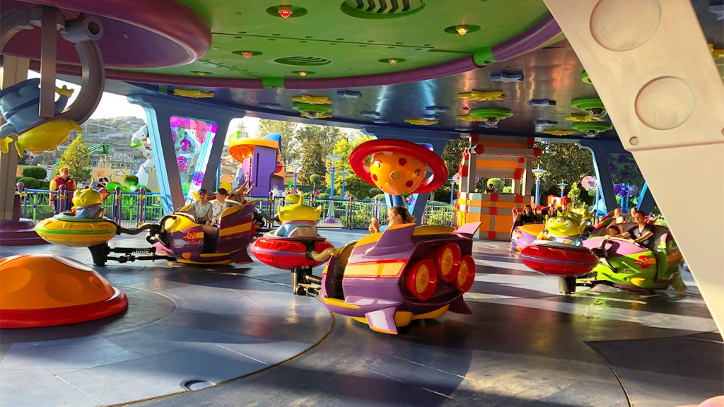 Guests ride in colourful spinning spaceships