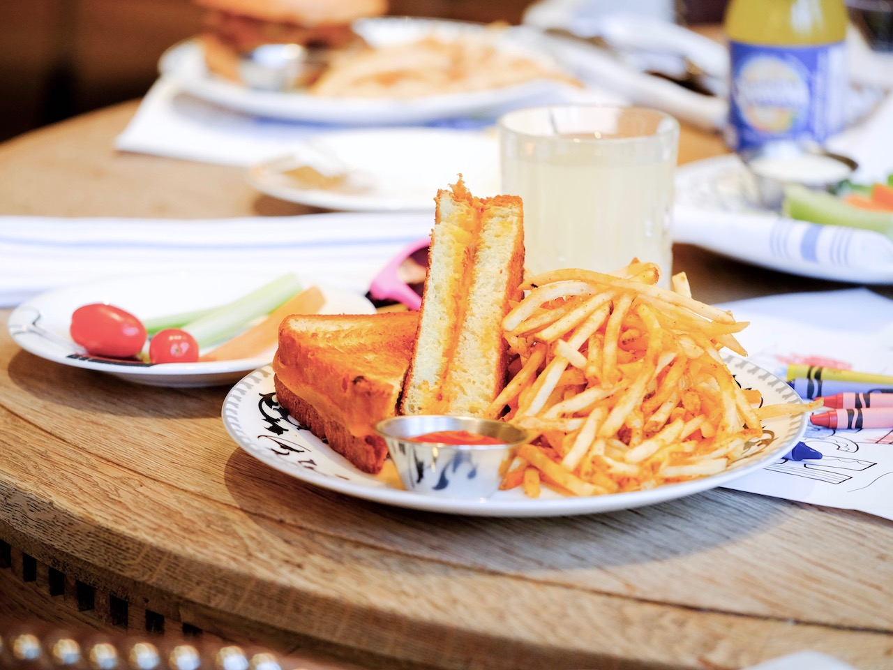plate of food with sandwich and French fries