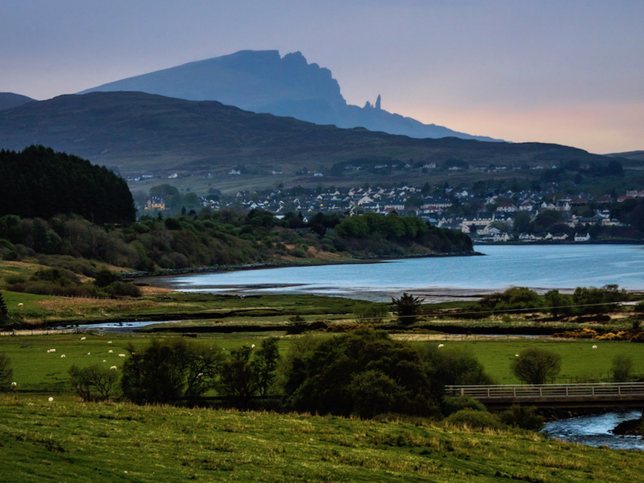 View across theTrotternish Peninsula overlooking the Sound of Raasay, Isle of Skye, Scotland, UK, with the town of Portree and The Old Man Of Storr in the distance.