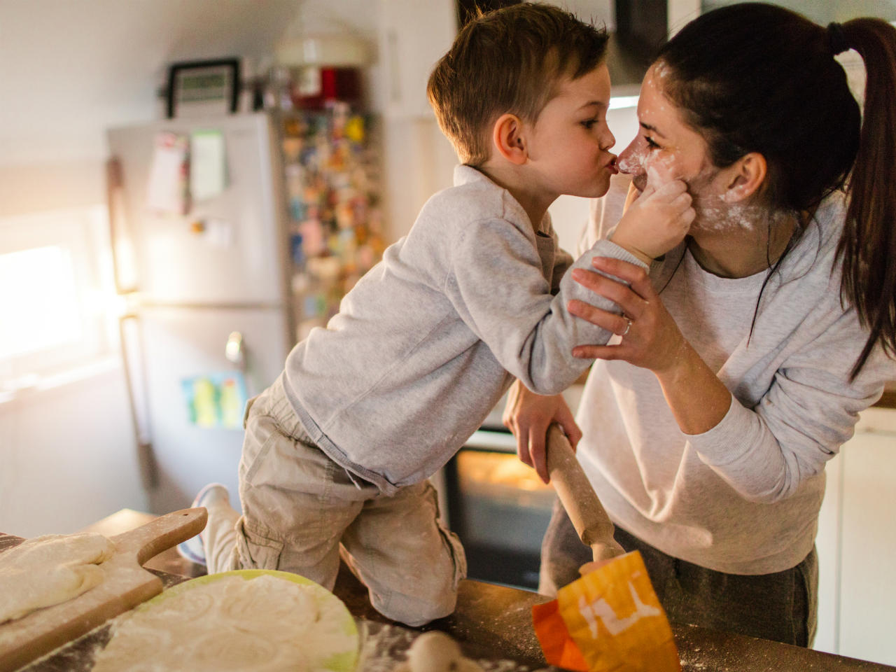 Mom and son being affectionate while baking together