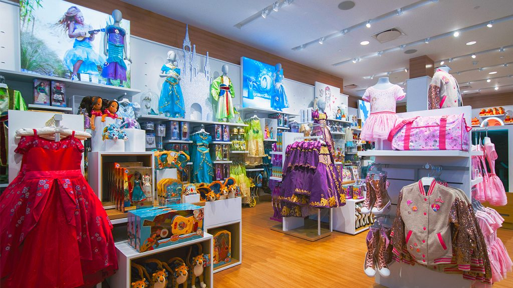 racks of Disney princess dresses and toys