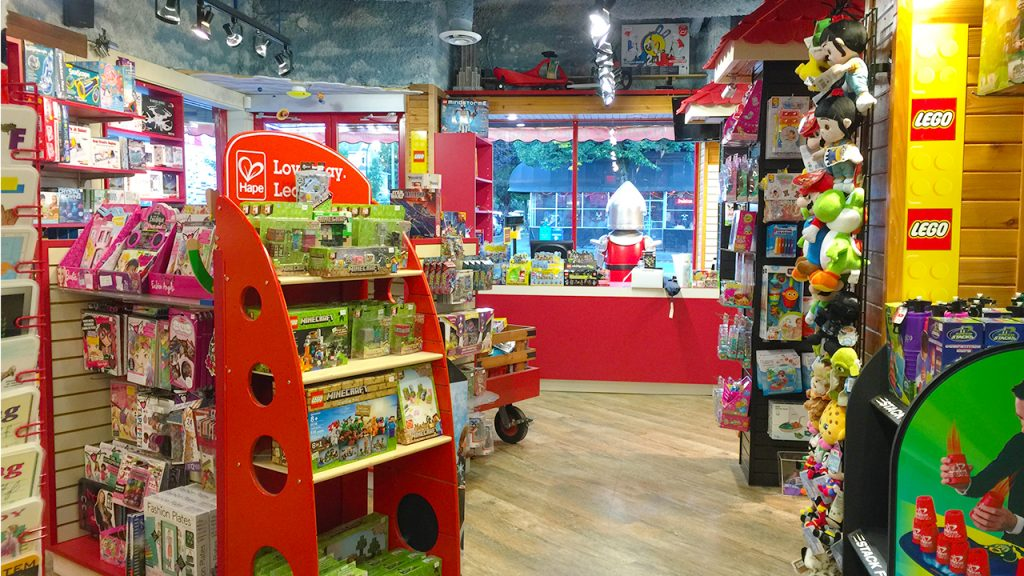 Shelves of wooden toys and games