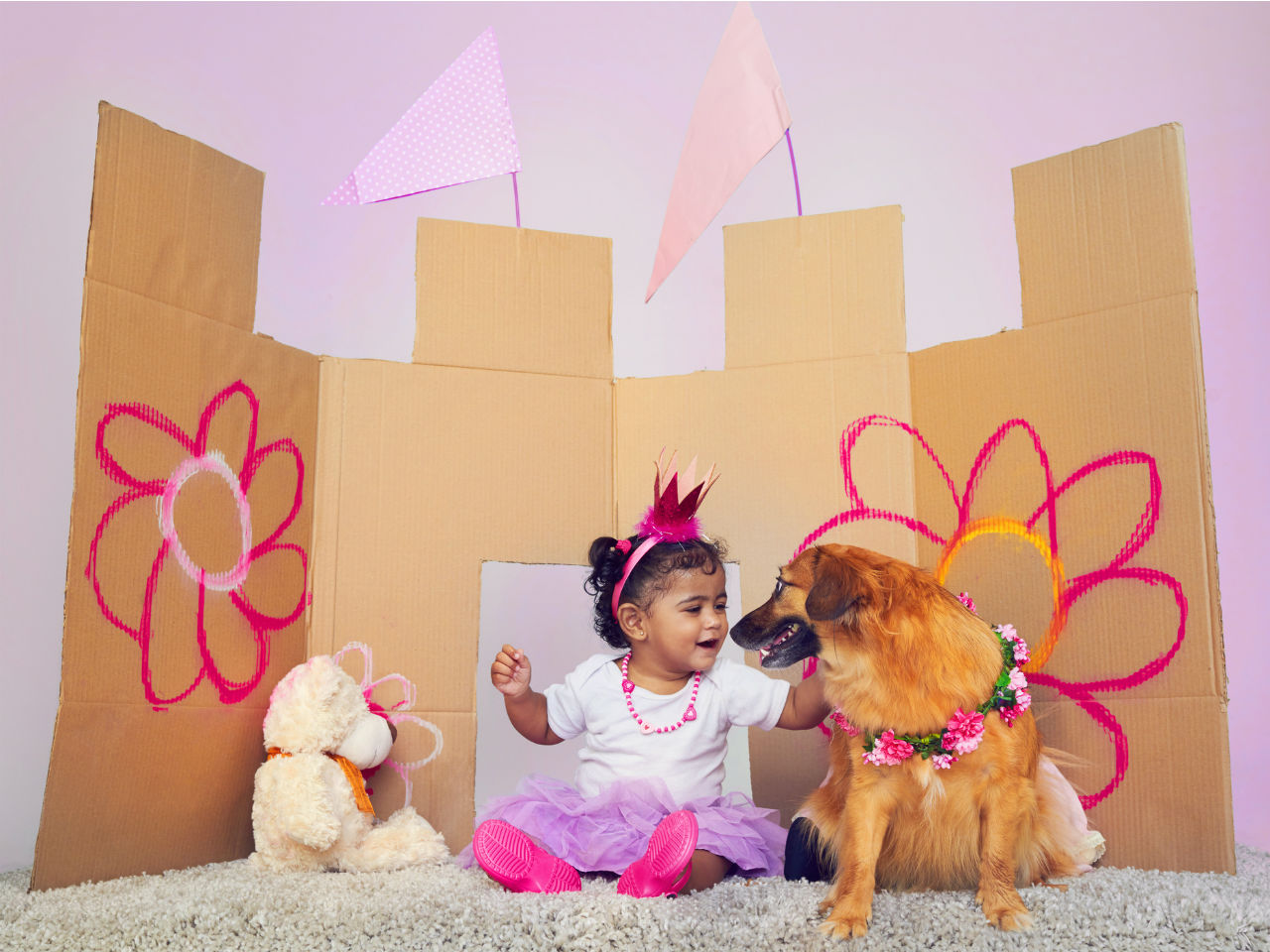 Little girl playing princess with her dog