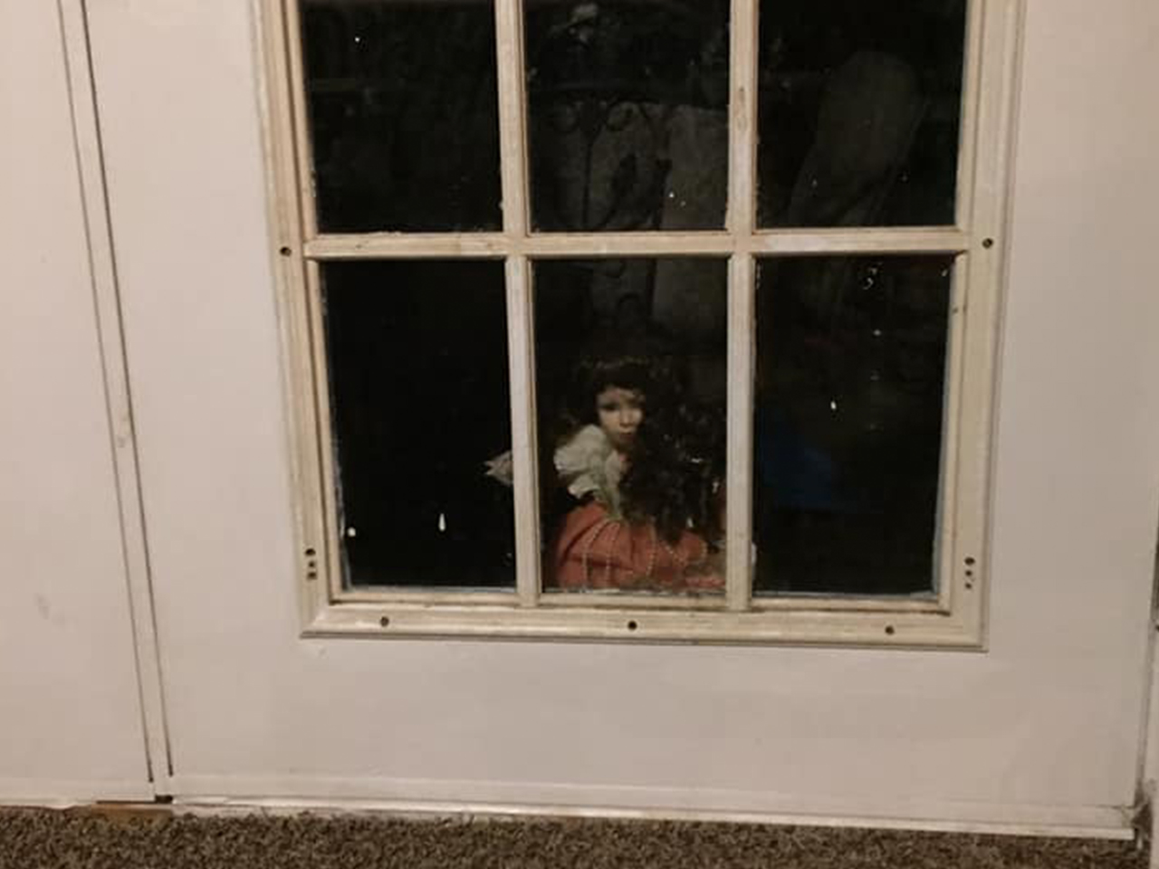 Doll In The Hall Is The Creepiest Elf On The Shelf Parody