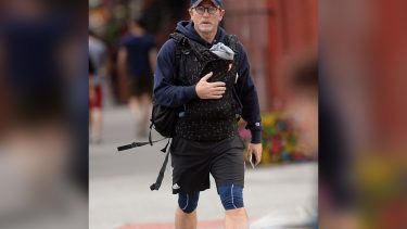 Daniel Craig carrying his baby in a carrier