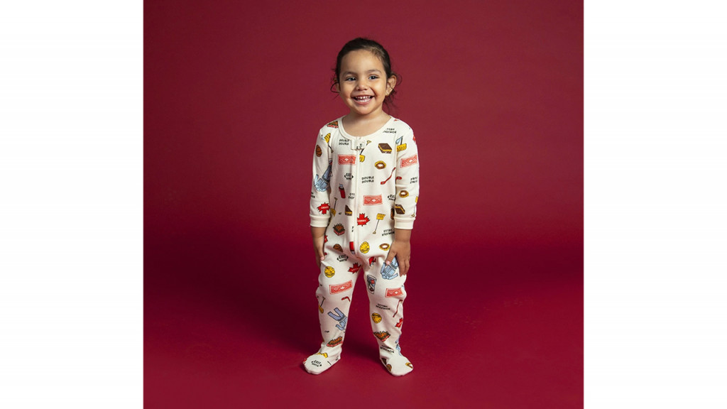 little girl wearing canada onesie