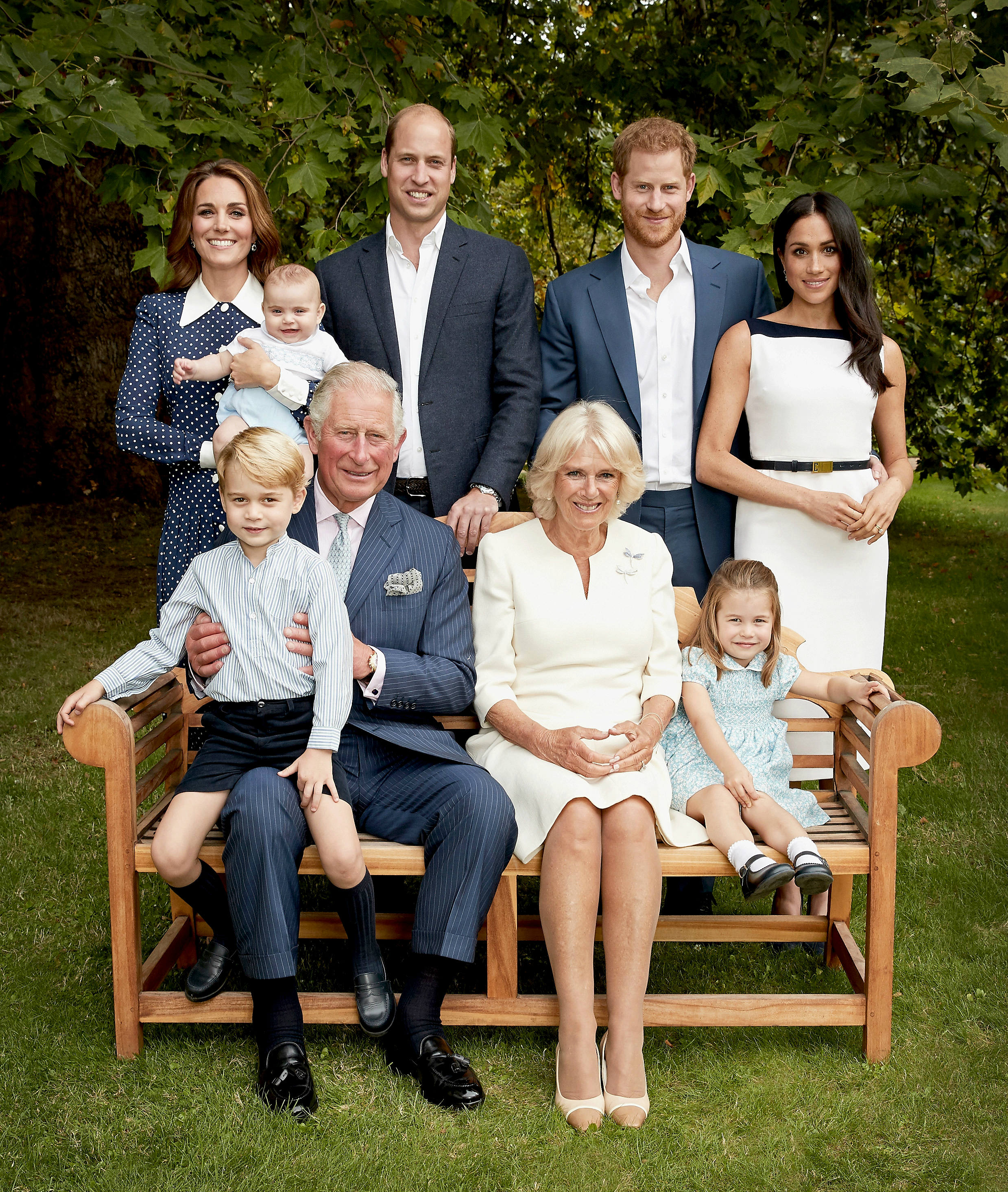 A picture of the royal family sitting in the gardens of Clarence House