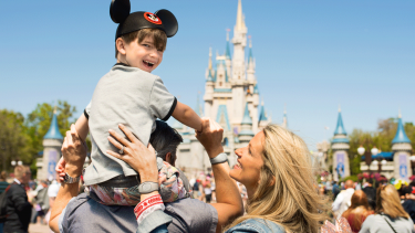 Family in front of Cinderella's Castle at Walt Disney World