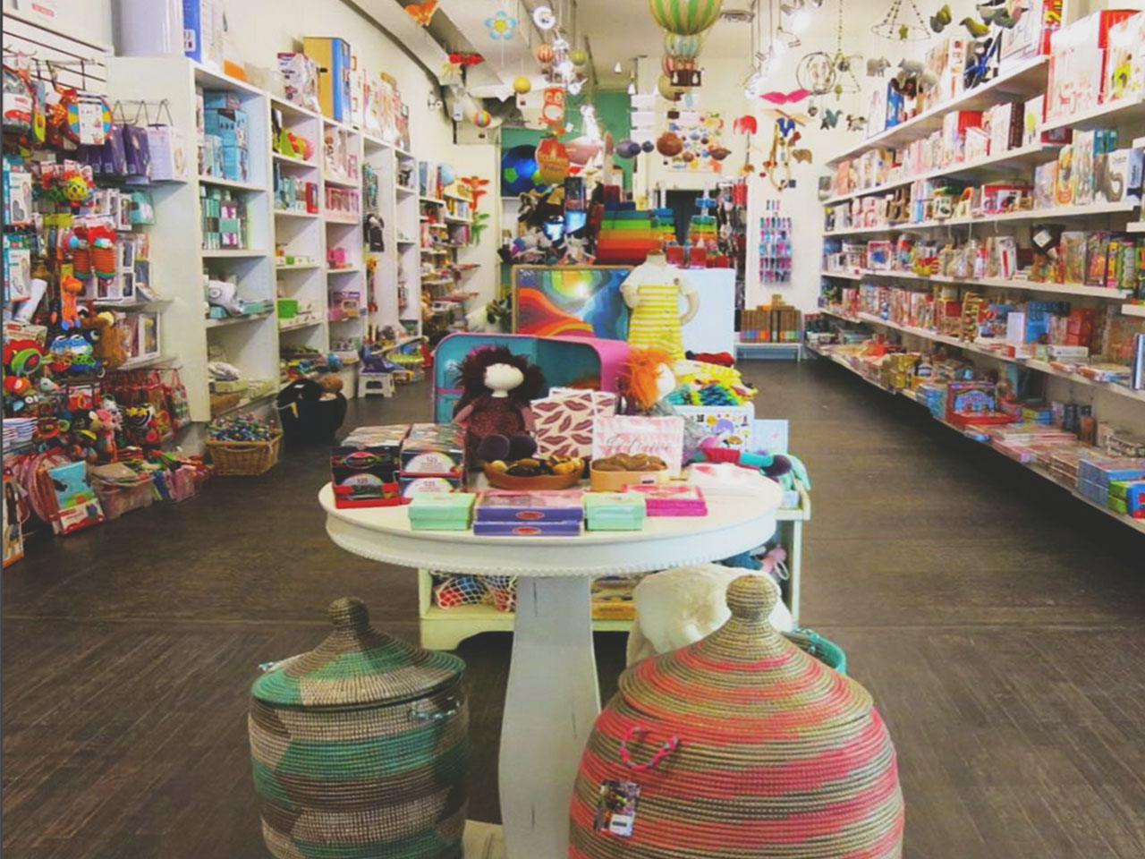 tables and shelves covered in colourful toys